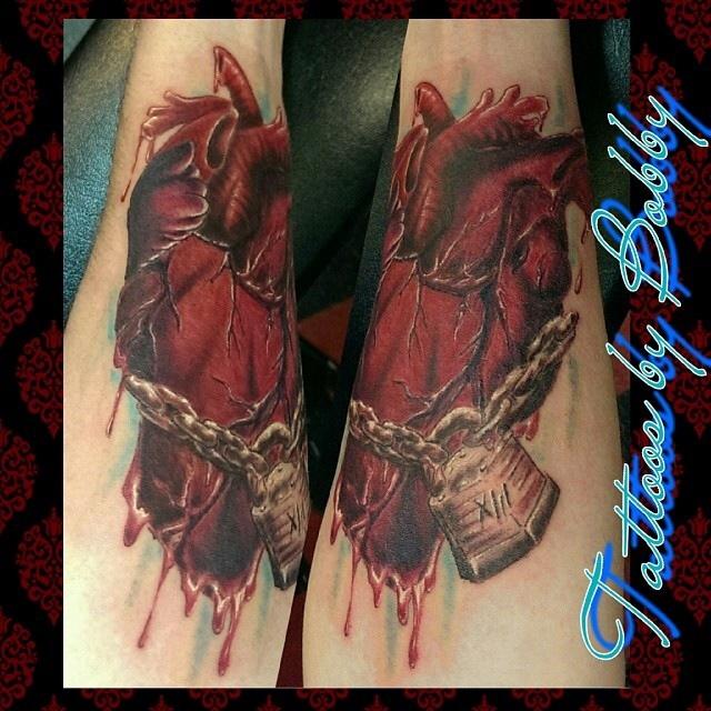 Custom anatomical heart with chain and lock - Tattoo.com