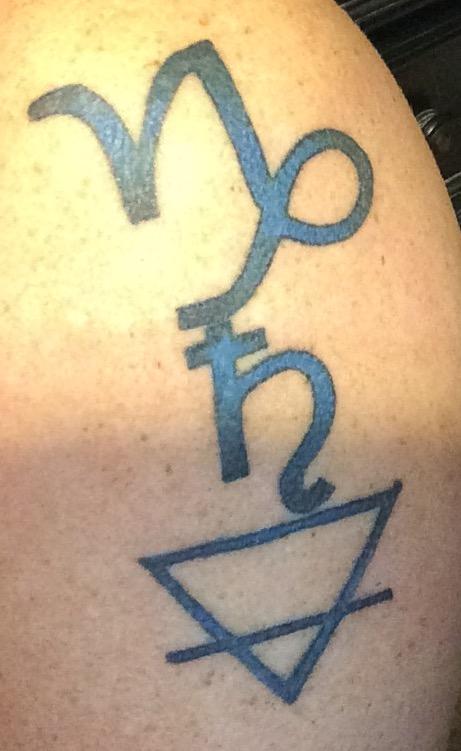 Capricorn, Saturn, Earth by Mutiny Tattoo in Jonesboro, AR