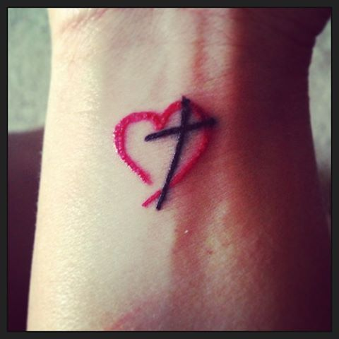 Small Red Heart Tattoo With A Black Cross Running Tattoocom