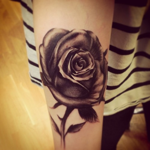 A Single Black Rose With A Stem With One Red Rose Petal Tattoocom