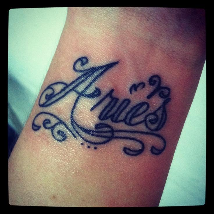 Aries Plain Black Cursive Wrist Tattoo