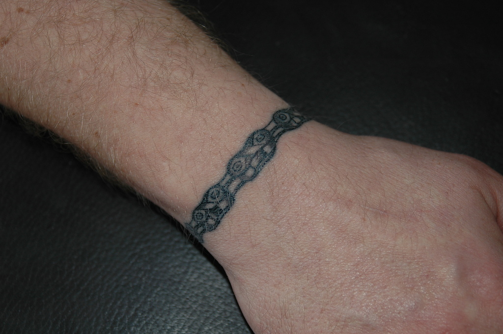 Chain Tattoo On Wrist: Bicycle Chain Wrapped Around The Left Wrist